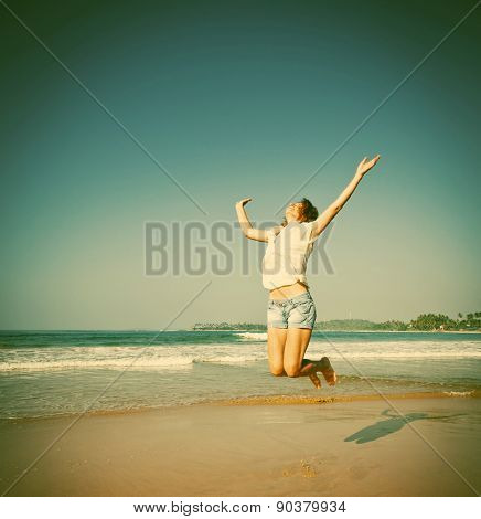 Woman Jumping In The Air On Tropical Beach - retro style background