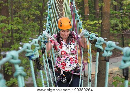 Person Climbing On A Rope