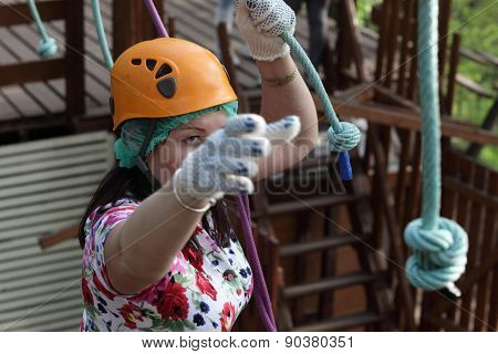 Woman Climbing At Adventure Park