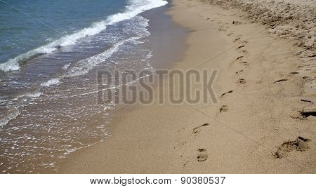 Footsteps in the sand at the beach