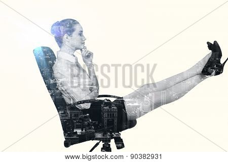 Businesswoman sitting on swivel chair with feet up against new york