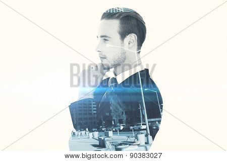 Thinking businessman standing with hand on chin against new york
