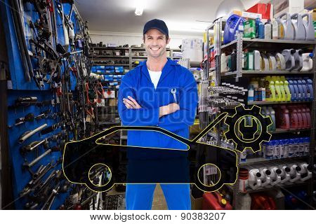 Confident mechanic holding wheel wrenches against full store room