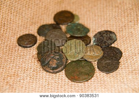Ancient   Coins With Portraits Of Kings On The Old Cloth