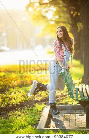 Young girl on roller skates in the park