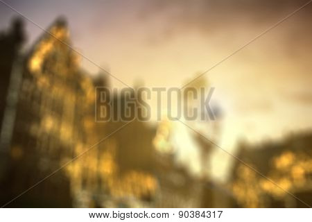 Defocused view of european city center houses against beautiful sunset, evening. Background with natural bokeh.