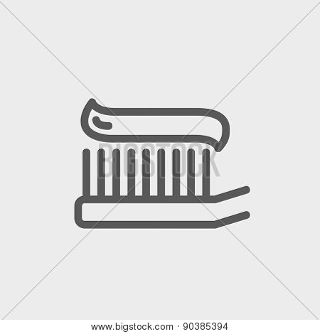 Toothbrush with toothpaste icon thin line for web and mobile, modern minimalistic flat design. Vector dark grey icon on light grey background.