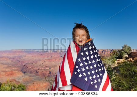 Cheerful small boy with USA flag, Grand Canyon