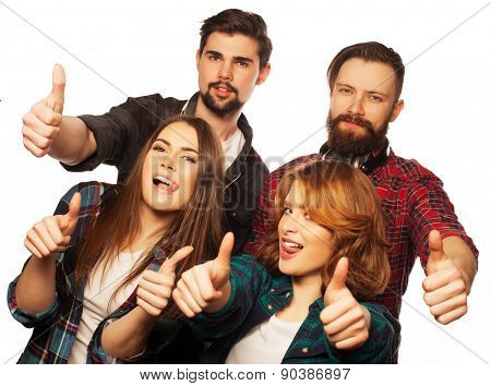 life style, education and people concept:  happy team of students showing thumbs up. Studio shot over white background. Hipster style. Special toning.