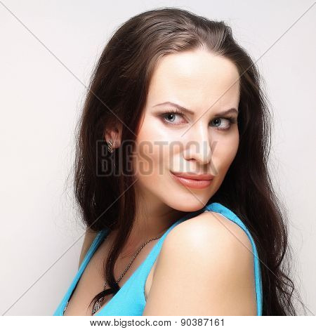 Portrait of a beautiful young woman thinkin