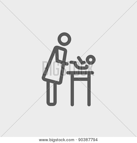 Woman changing the diaper icon thin line for web and mobile, modern minimalistic flat design. Vector dark grey icon on light grey background.