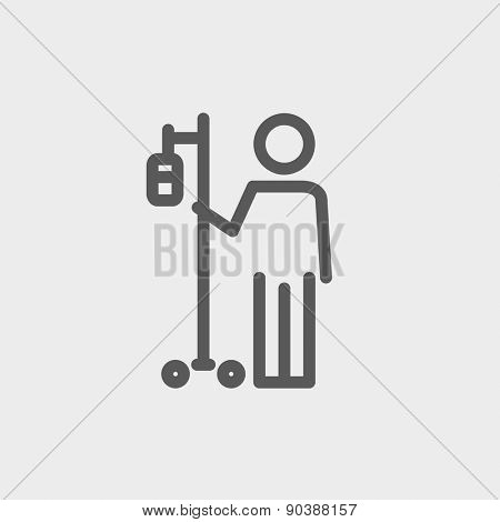 Patient standing with intravenous saline solution icon thin line for web and mobile, modern minimalistic flat design. Vector dark grey icon on light grey background.