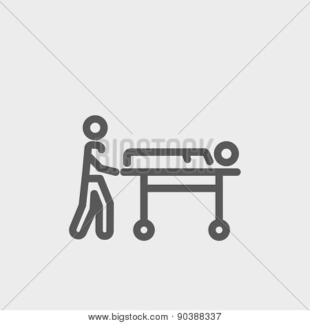 Man pushing the stretcher with sick person icon thin line for web and mobile, modern minimalistic flat design. Vector dark grey icon on light grey background.