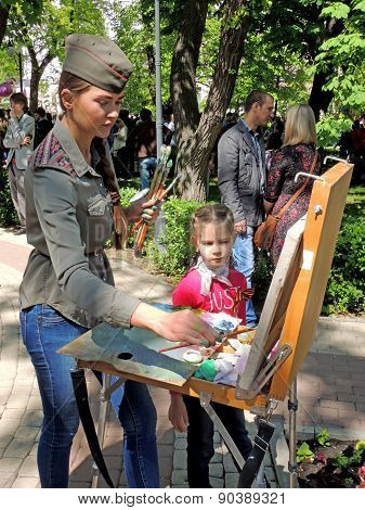 Drawing Girl In Field Cap With Easel In The Park