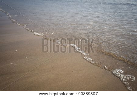 Tide Line On A Beach