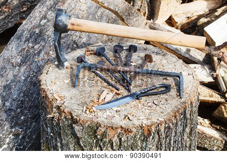 Hew Axe And Metal Hardware On Wooden Block
