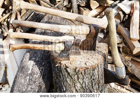 Many Various Axes In Wooden Block