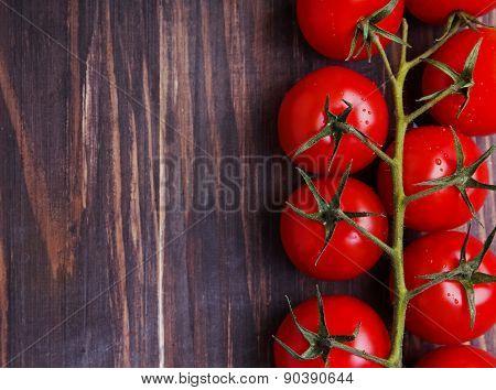 Brunch Of Cherry Tomatoes. Dark Toned Photo