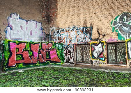 Abandoned Urban Courtyard With Colorful Graffiti