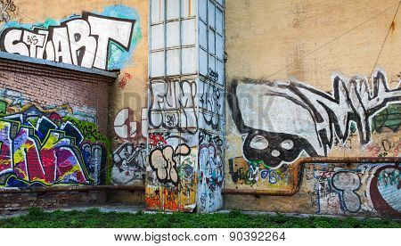 Abandoned Urban Courtyard With Abstract Graffiti