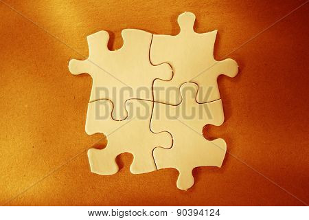 Four jigsaw puzzle pieces together