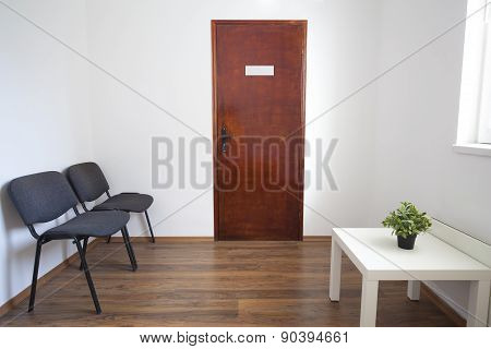 Small Waiting Room With Closed Door
