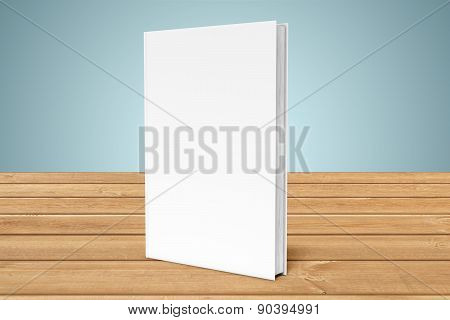 Copy-book on the edge of table