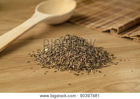Spice Cumin On A Wooden Table.