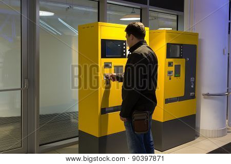 Man Pays Parking In Parking Machine In The Mall