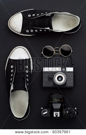 Sneakers, Photo Camera, And Round Sunglasses