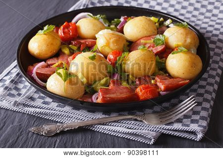 Appetizing New Potatoes With Fried Bacon And Herbs On A Plate