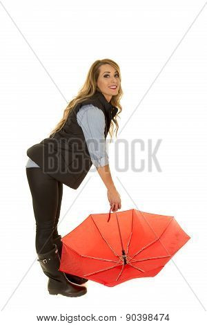 Woman In A Black Jacket Lean Over With Umbrella