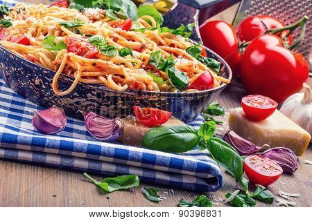 Spaghetti bolognese with cherry tomato and basil. Spaghetti with tomato sauce.