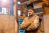 picture of protective eyewear  - Young man in a factory in protective workwear - JPG