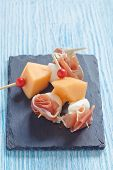 stock photo of canapes  - Appetizer canape with melon - JPG