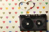 pic of magnetic tape  - Audio cassette with magnetic tape in shape of heart on paper background - JPG