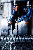 stock photo of machine  - CNC machining station at work - JPG