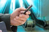 image of escalator  - man holds phone in hand near the escalator - JPG