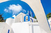 picture of greek  - A view of a Greek church with iconic blue and white colors against clear blue sky on Greek island - JPG