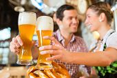 picture of restaurant  - Couple drinking wheat beer in bavarian restaurant - JPG