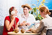 picture of shells  - Woman in travel agency shell to shell - JPG