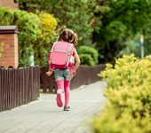 foto of little school girl  - little girl with a backpack going to school - JPG