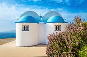 picture of greek-island  - A view of a church with iconic blue roof and see in the background on Greek island - JPG