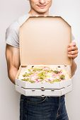 stock photo of carbonara  - Pizza delivery courier - JPG