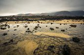 foto of canary-islands  - beautiful desert mountain landscape with water on the island of Lanzarote - JPG