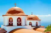 stock photo of greek-island  - A view of a typical church with red roof on Greek island - JPG
