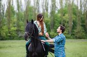 foto of appaloosa  - pair of lovers walk with a horse - JPG
