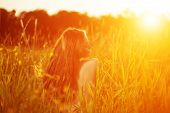 image of allergy  - Young hipster model woman Casual Girl in field in Sunset in spring - JPG
