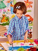 picture of nursery school child  - Little girl painting child paint in school - JPG