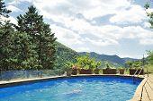 stock photo of apennines  - Italian countryside with pool - JPG